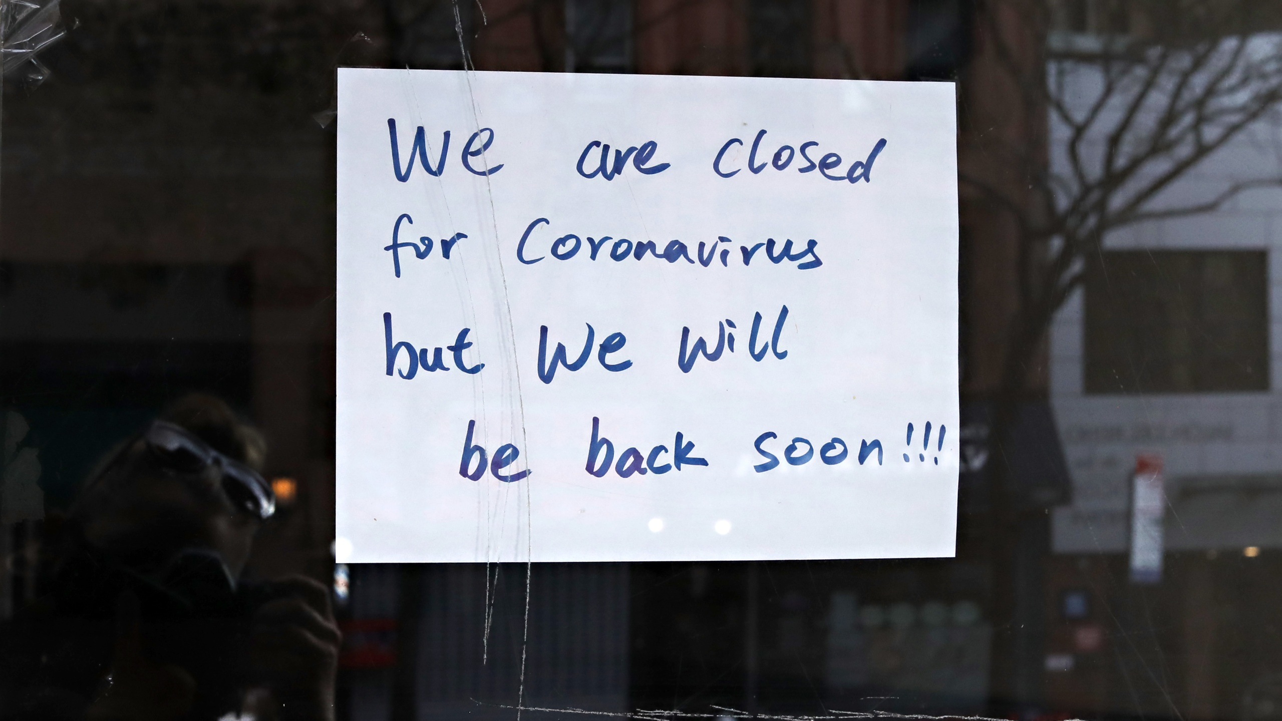 """A sign in a restaurant window reads """"we are closed for coronavirus but we will be back soon!!!"""" on April 21, 2020 in New York City. (Cindy Ord/Getty Images)"""