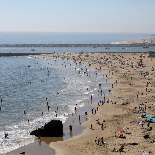 People are seen gathering on the Corona del Mar State Beach on April 25, 2020, in Newport Beach, California. (Michael Heiman/Getty Images)