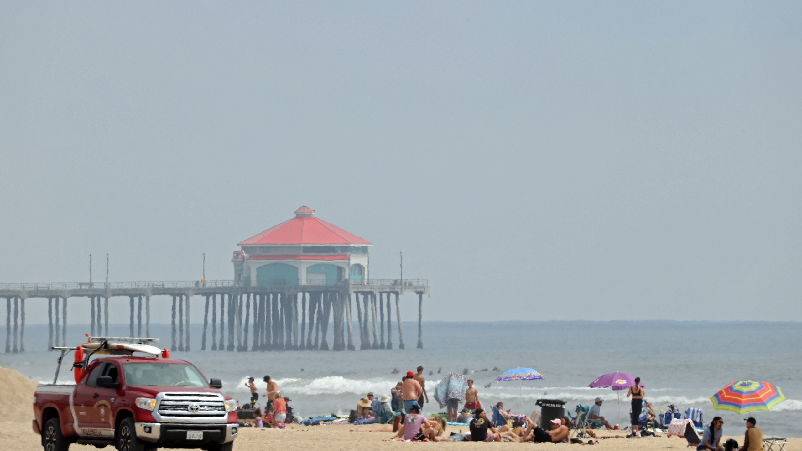 A lifeguard patrols as people gather in front of the Huntington Beach pier on April 30, 2020. (Credit: Michael Heiman / Getty Images)
