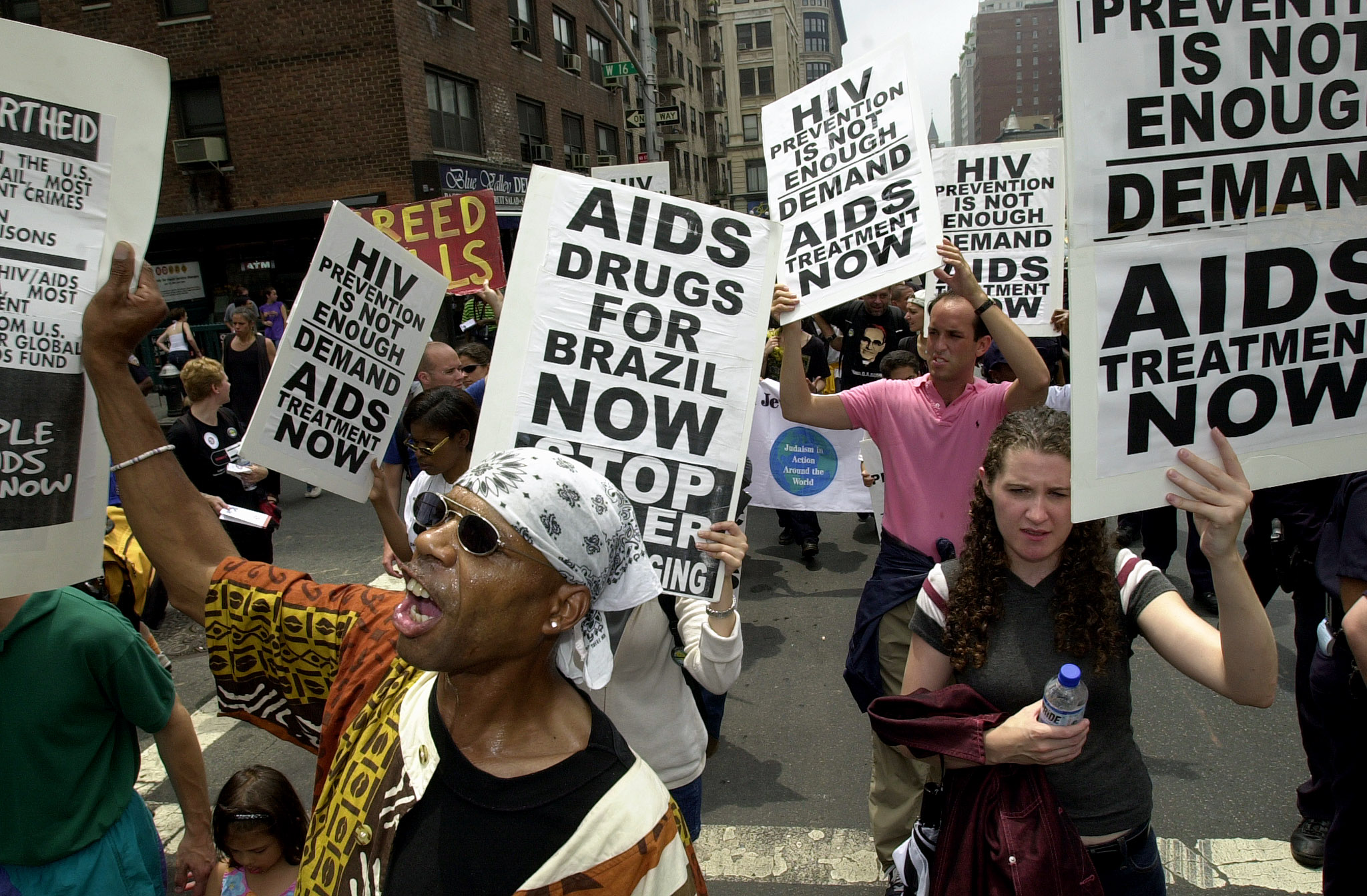 AIDS activists, church groups and anti-debt activists shout slogans as they march up Sixth Avenue in New York on June 23, 2001. (STAN HONDA/AFP via Getty Images)
