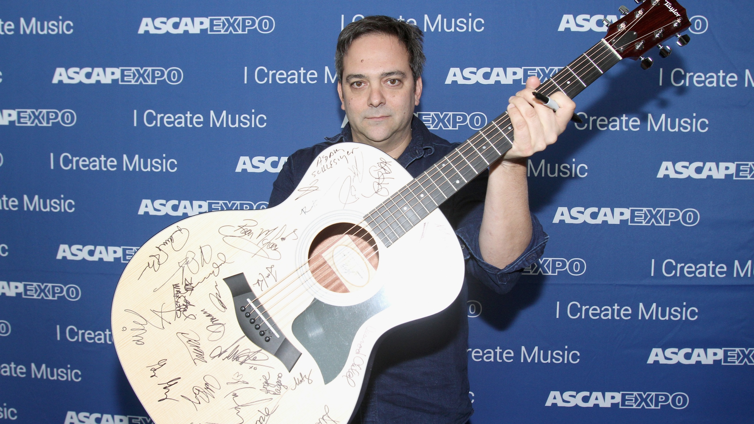 Composer Adam Schlesinger poses with a #StandWithSongwriters guitar on April 30, 2016 in Los Angeles. (Maury Phillips/Getty Images for ASCAP)