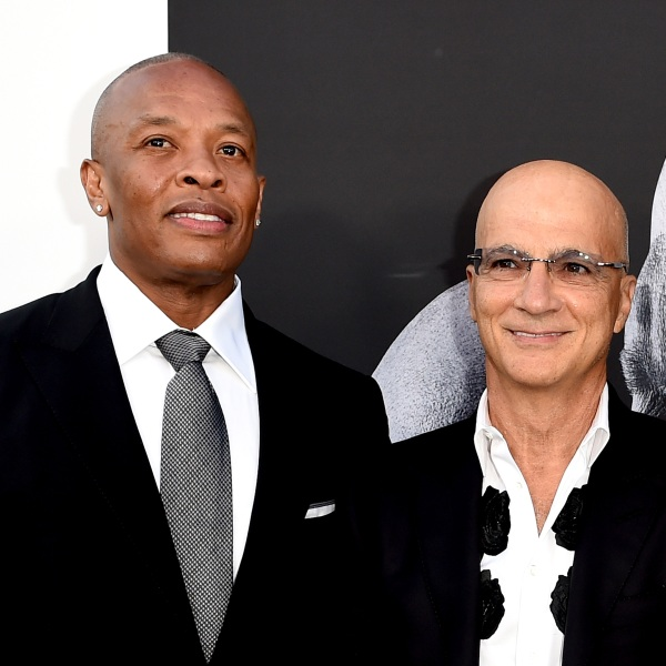 """Dr. Dre and Jimmy Iovine arrive at the premiere screening of HBO's """"The Defiant Ones"""" at Paramount Studios on June 22, 2017, in Los Angeles. (Kevin Winter/Getty Images)"""