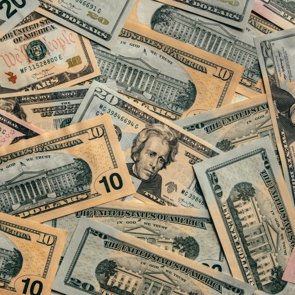 Cash is seen in a file photo. (Credit: iStock/Getty Images Plus)