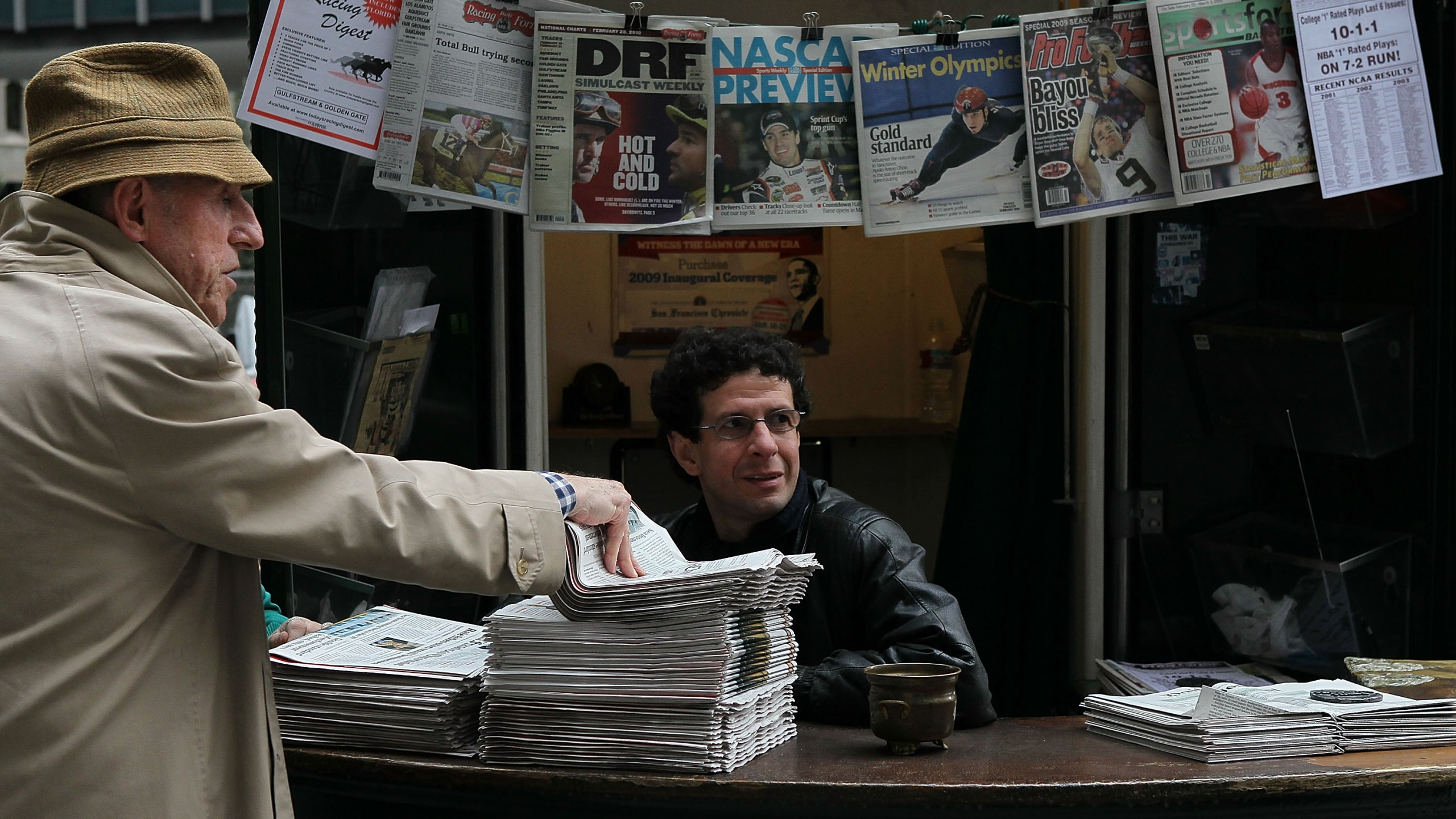 A customer buys a copy of the San Francisco Chronicle from Karim Benkanoun (R) at Nick's Newsstand February 26, 2010 in San Francisco, California. (Justin Sullivan/Getty Images)