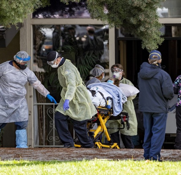 Patients are removed from Magnolia Rehabilitation and Nursing Center in Riverside in April 2020 after dozens tested positive for the coronavirus and staffers, afraid for their safety, stopped showing up for shifts.(Gina Ferazzi / Los Angeles Times)