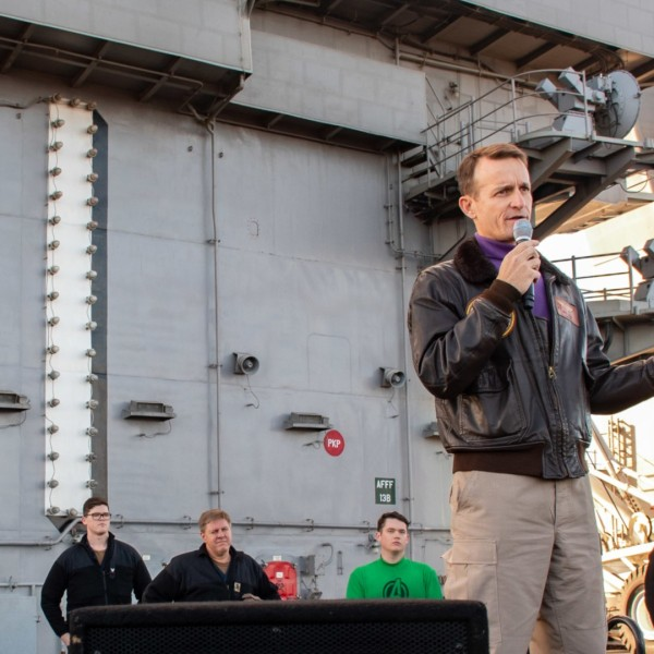 In this handout released by the U.S. Navy, Capt. Brett Crozier, commanding officer of the aircraft carrier USS Theodore Roosevelt (CVN 71), gives remarks during an all-hands call on the ships flight deck Dec. 15, 2019. (U.S. Navy via Getty Images)