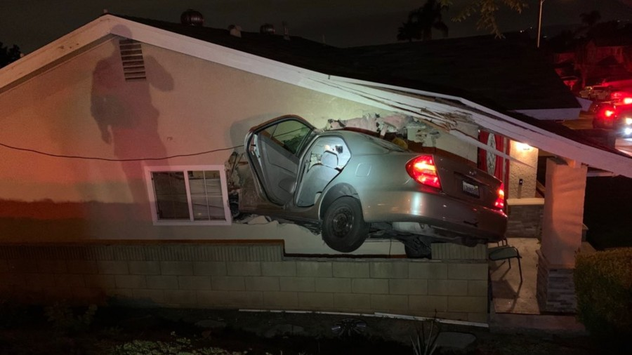 A driver and passenger ran away after this car careened into the side of a Rowland Heights house on April 18, 2020. (California Highway Patrol)