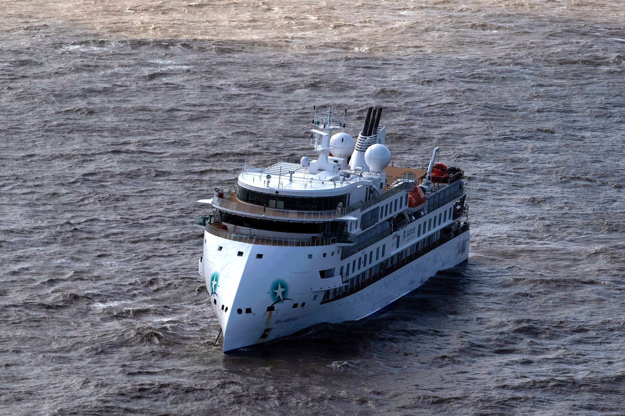 The Greg Mortimer, a cruise liner operated by Australia's Aurora Expeditions, departed March 15 on a voyage to Antarctica and South Georgia. Since the beginning of April, however, the ship has been stuck off the coast of Uruguay, after authorities refused to allow passengers to disembark due to the risk of coronavirus. (Pablo Porciuncula/AFP via Getty Images)