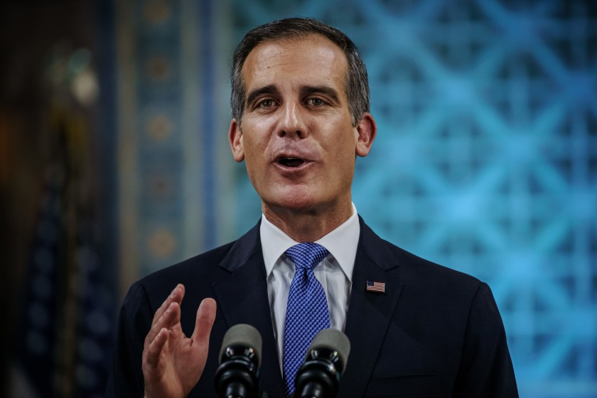 Mayor Eric Garcetti delivers his State of the City address Sunday night in a nearly empty City Council chamber on April 19, 2020.(Marcus Yam/Los Angeles Times)