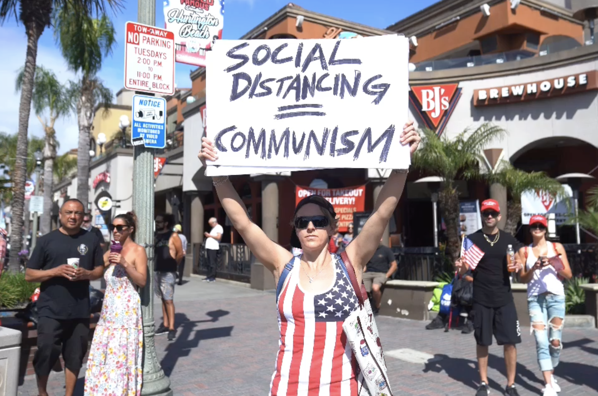 Defying Social Distancing Rules Demonstrators Gather In Huntington Beach To Protest California S Stay At Home Order Ktla