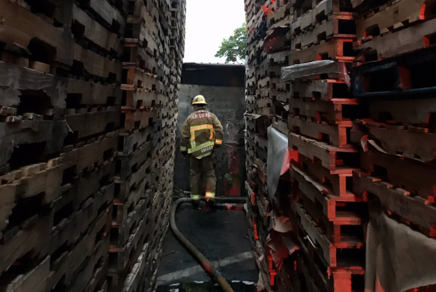 Stacks of wooden pallets are seen at a yard in the City on Industry on April 19, 2020, when a person was killed in a fire there. (Los Angeles County Fire Department)