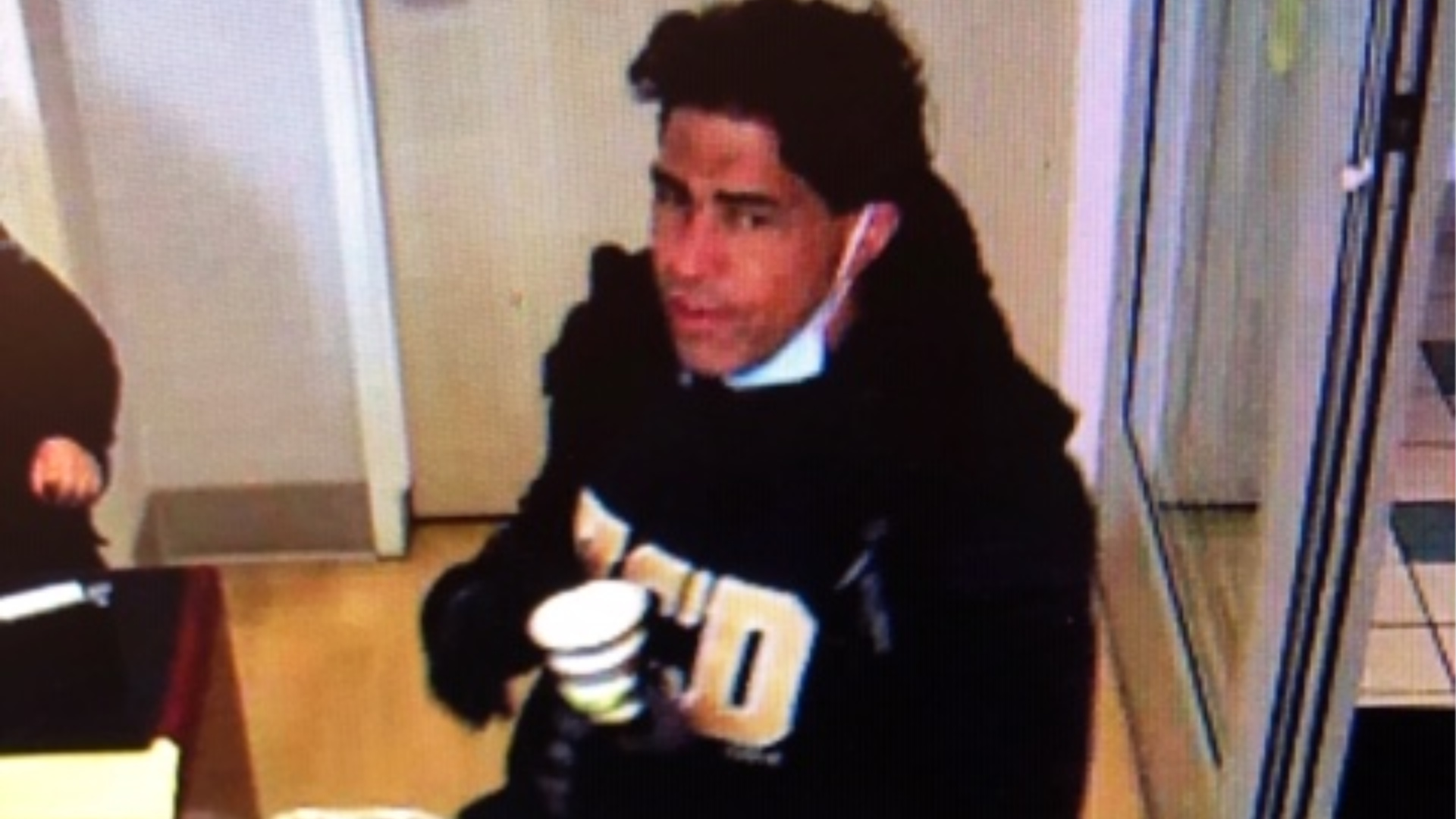 A surveillance image shows a man suspected of stealing a COVID-19 sample from a Davis hospital. (Davis Police via KTXL)