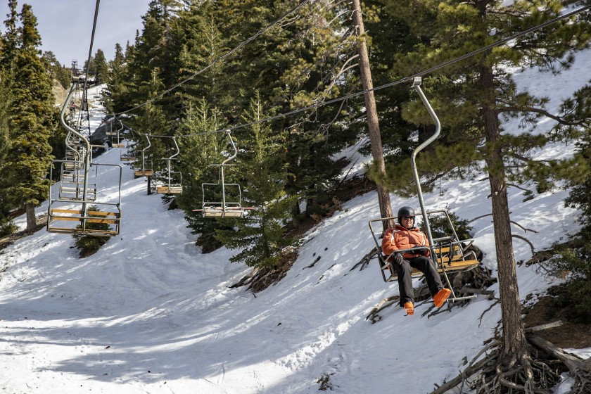 A rider is seen in a lift at Mt. Baldy in this file photo. (Brian van der Brug / Los Angeles Times)