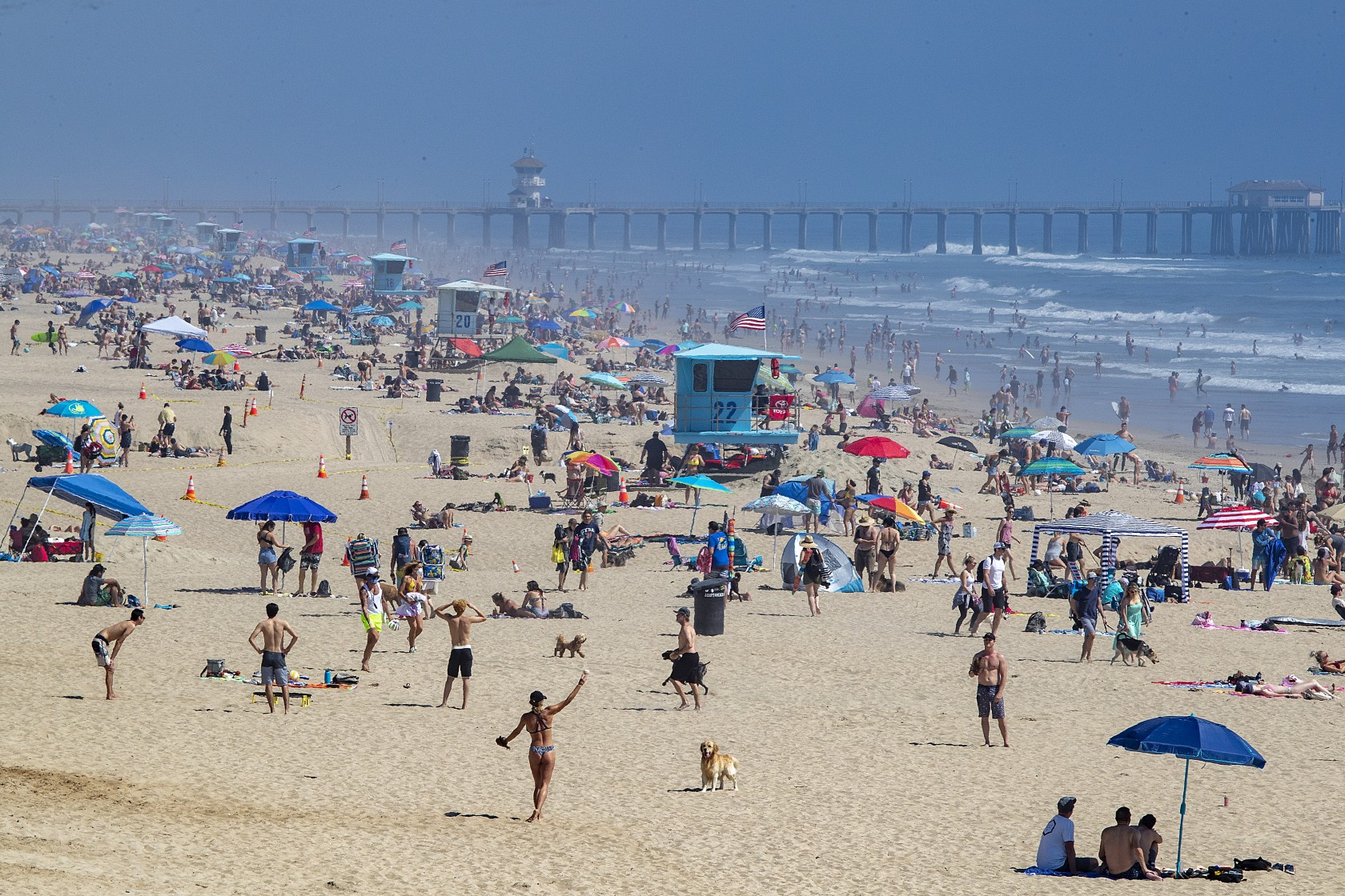 Thousands of beachgoers enjoy a sunny day at Huntington Beach despite the state-mandated stay-at-home order on April 25, 2020. (Allen J. Schaben/Los Angeles Times)