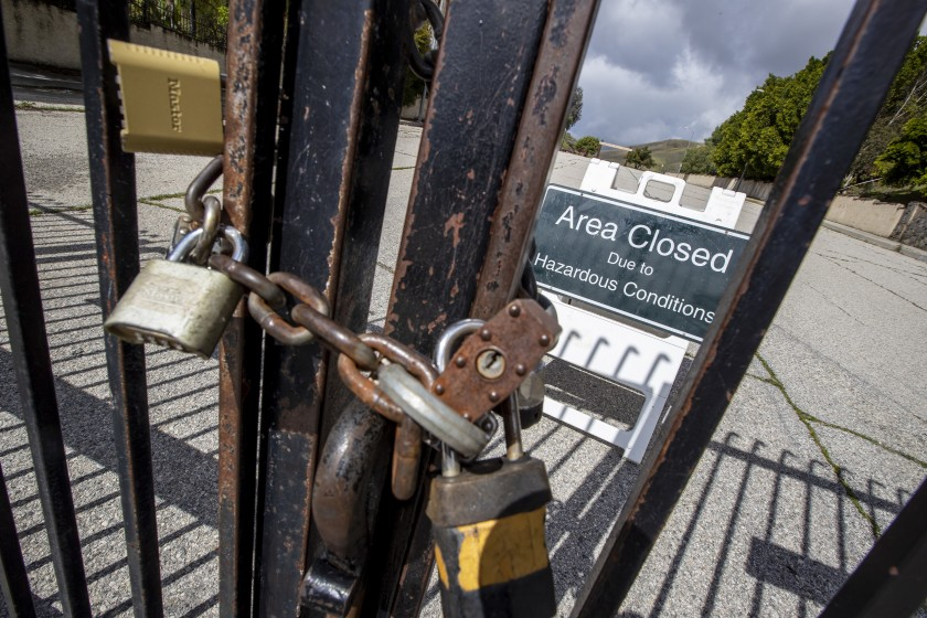 Padlocks seal a gate for the Victory Trailhead at the Upper Las Virgenes Open Space Preserve in Woodland Hills.(Brian van der Brug / Los Angeles Times)