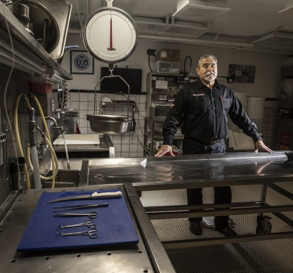 Vidal Herrera is pictured inside the lab of his company, 1-800-Autopsy, in April 2020. The business has been flooded with requests for private autopsies from people around the country who want to know whether a loved one died of COVID-19. (Robert Gauthier / Los Angeles Times)