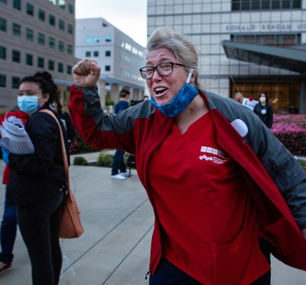 Marsha Santini, a RN at UCLA Medical Center, along with fellow nurses protest the lack of personal protective equipment (PPE) for frontline health care workers at the UCLA Ronald Regan Medical Center in Los Angeles.(Jason Armond / Los Angeles Times)