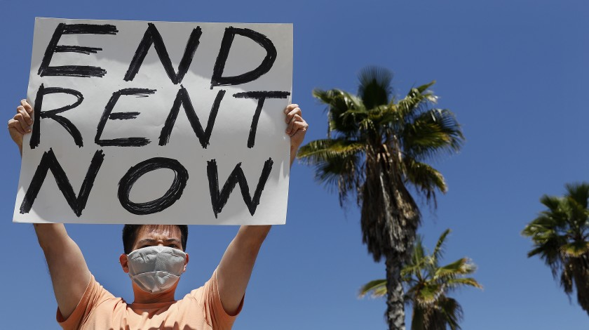 A protesters demands rent forgiveness for the month of April due to the coronavirus pandemic's economic fallout. (Los Angeles Times)
