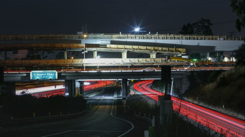 Construction crews work to complete a bridge for the Crenshaw Line along Florence Avenue in Inglewood in 2017. (Jay L. Clendenin / Los Angeles Times)