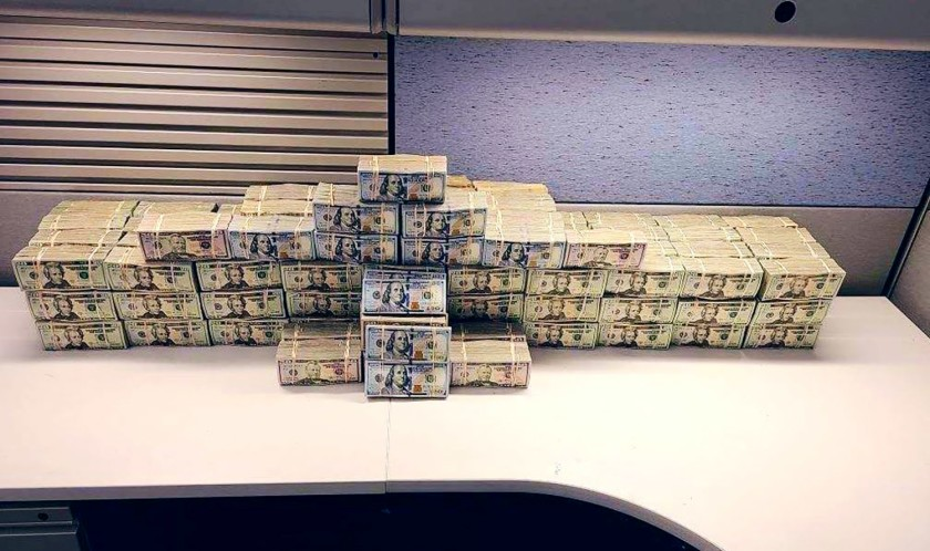 Piles of seized cash are seen in this undated photo. (Drug Enforcement Administration via Los Angeles Times)