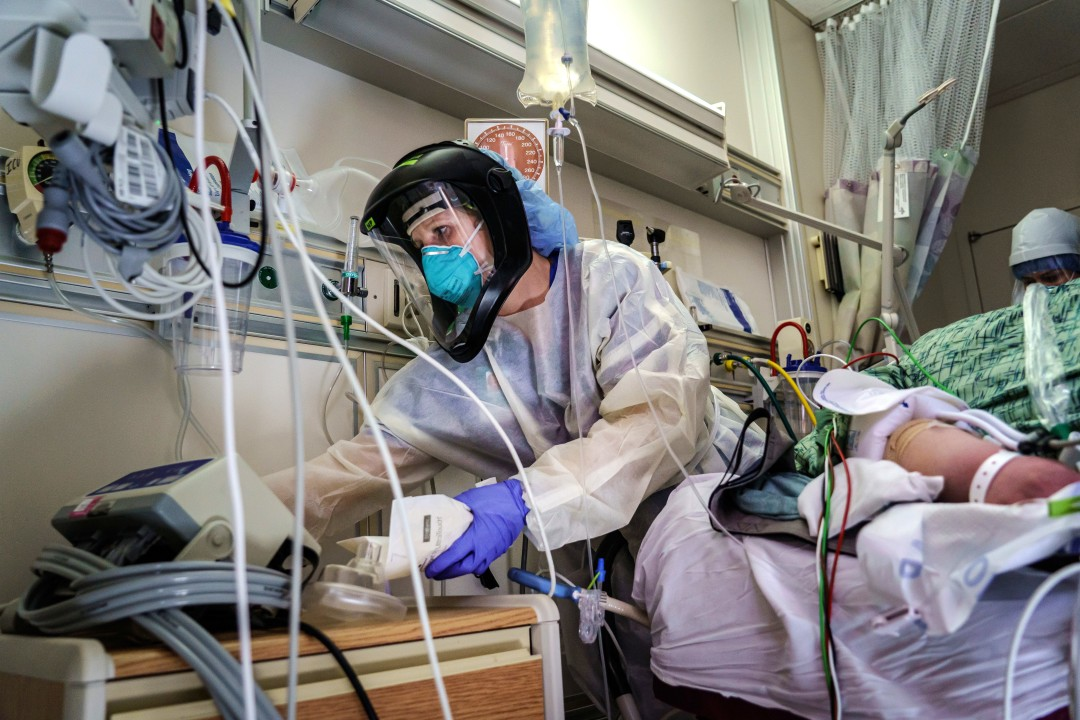 A nurse practitioner readies her supplies to stabilize a patient who has just been intubated at Scripps Mercy Hospital Chula Vista. (Marcus Yam / Los Angeles Times)