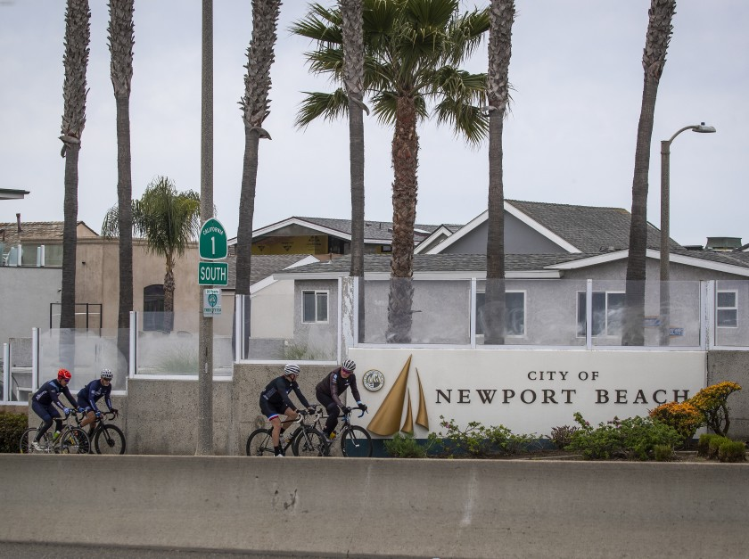 Cyclists have the street to themselves in Newport Beach on March 31, 2020. (Credit: Allen J. Schaben / Los Angeles Times)
