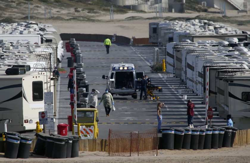 More than 100 RVs are parked at Dockweiler State Beach in Los Angeles to house people who have tested positive or have symptoms of COVID-19. Many of the patients are homeless.(Luis Sinco / Los Angeles Times)