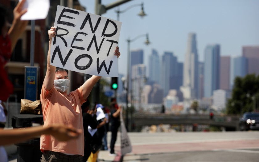 Protesters with the Los Angeles Tenants Union and other groups hold a rally at Mariachi Plaza in Boyle Heights to demand rent forgiveness for April 2020 because of the coronavirus pandemic. (Christina House/Los Angeles Times)