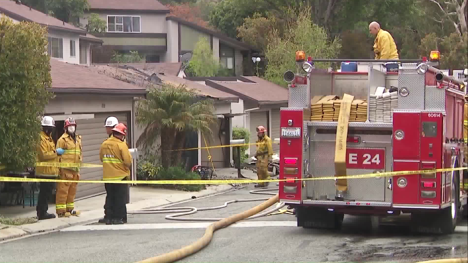 Crews respond to a deadly blaze at a townhouse in Sunland on April 13, 2020. (Credit: KTLA)