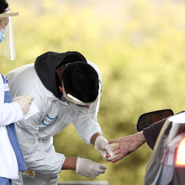 A medical professional administers a coronavirus test at a drive-thru location at the Bolinas Fire Department on April 20, 2020 in Bolinas. (Ezra Shaw/Getty Images)