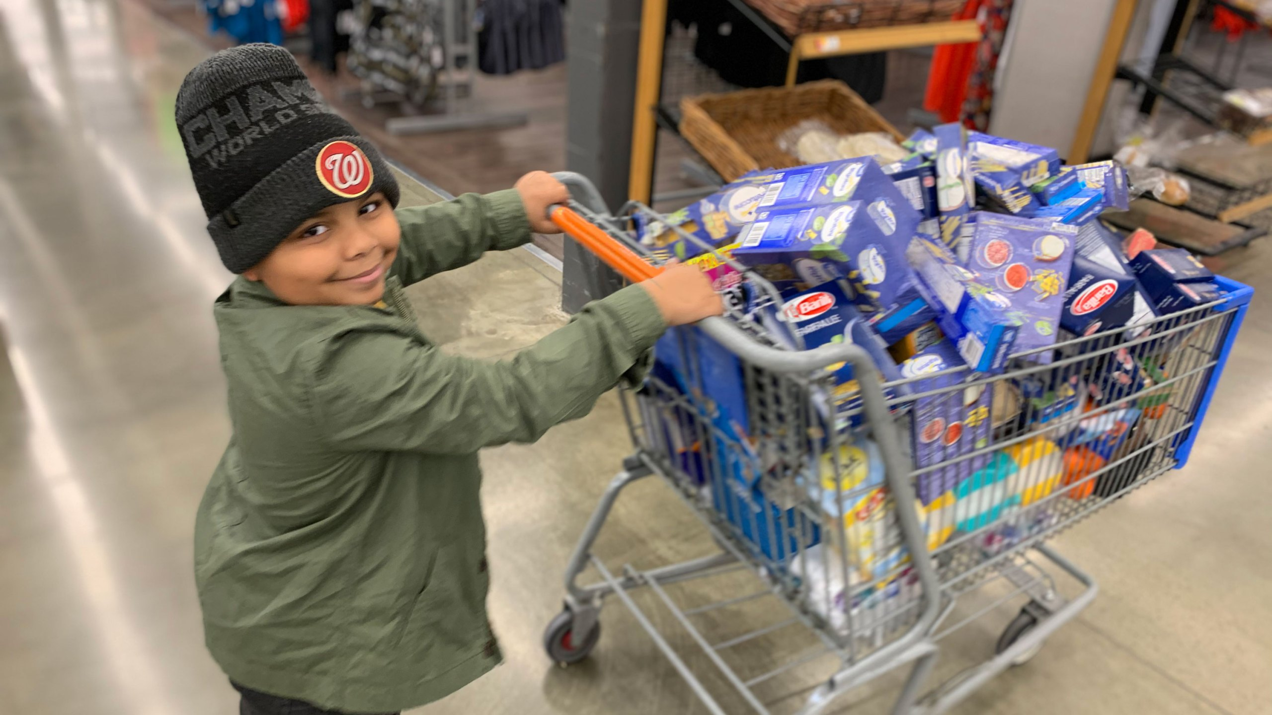 Cavanaugh Bell, 7, shops for items to make care packages for seniors. (Llacey Simmons)