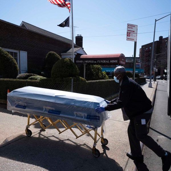 William Samuels delivers caskets to the Gerard Neufeld Funeral Home, Friday, March 27, 2020 during the coronavirus pandemic in the Queens borough of New York. (Mark Lennihan/AP)