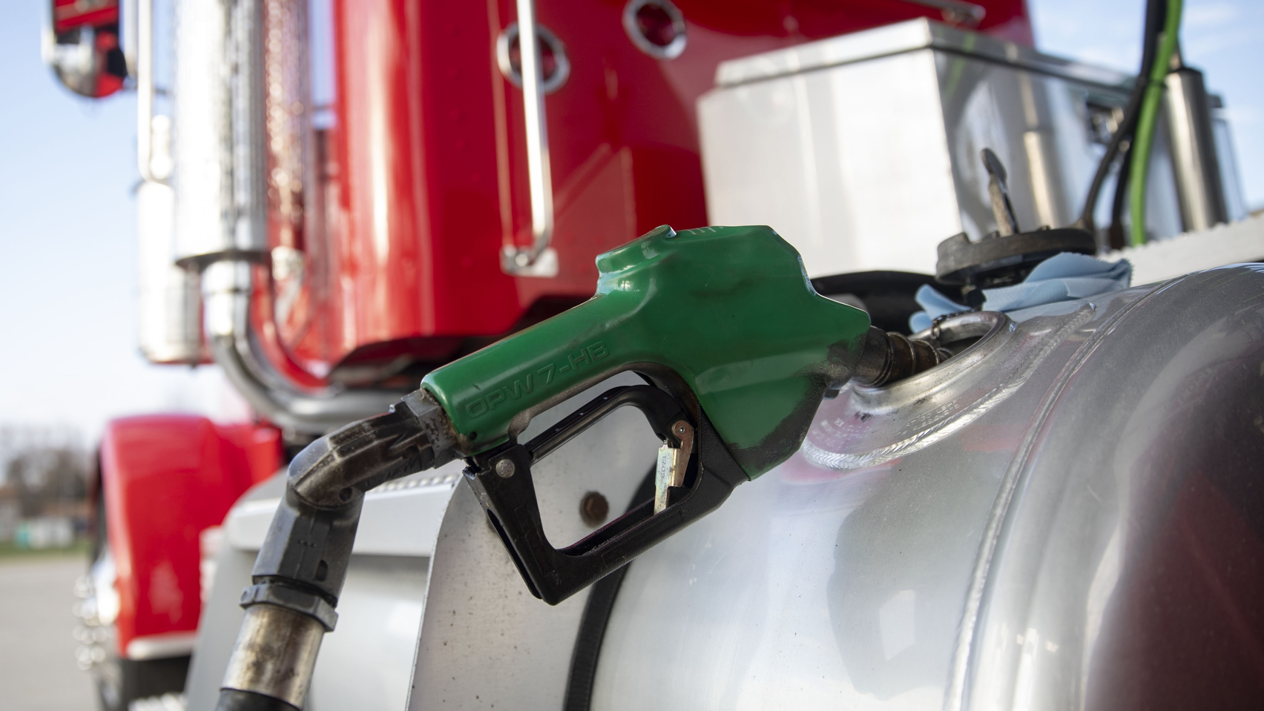 A filler nozzle pumps fuel into the gas tank of a tractor trailer in a file photo. (Daniel Acker/Bloomberg/Getty Images)