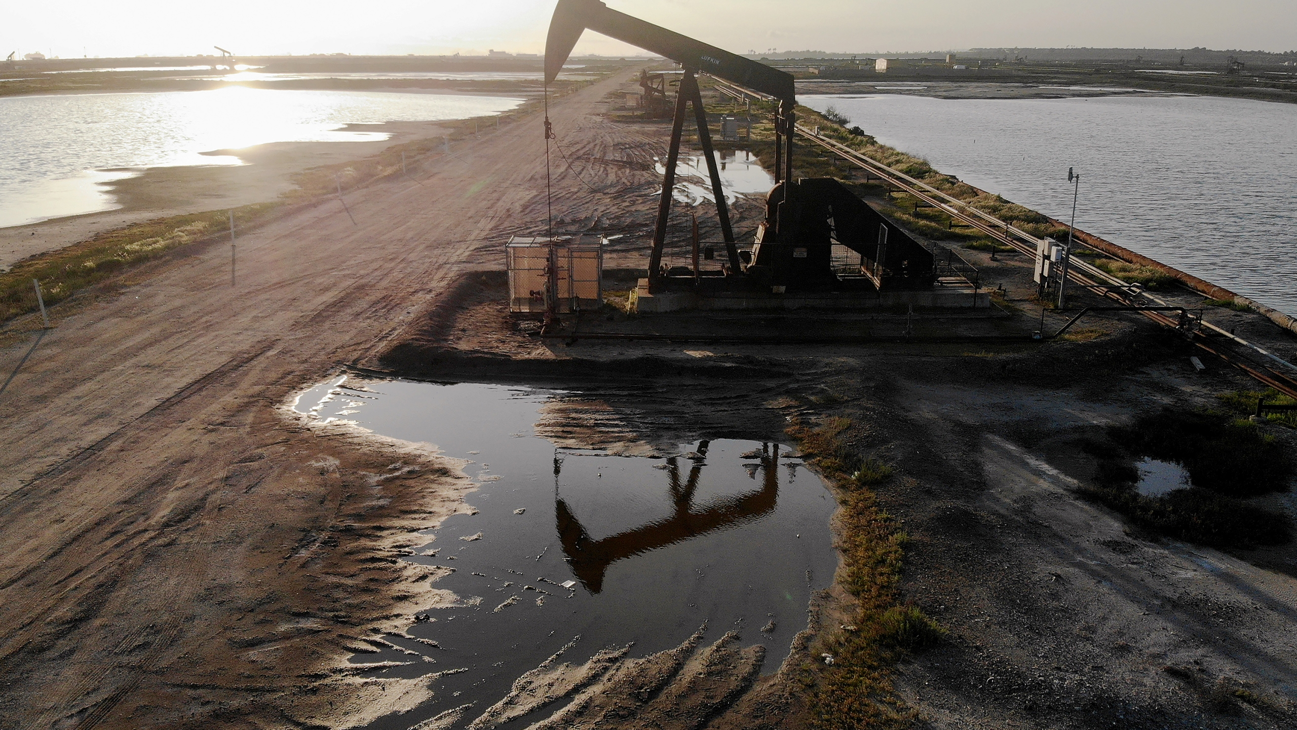 An aerial view shows an oil pumpjack at the Huntington Beach Oil Fields amidst the coronavirus pandemic on April 20, 2020 in Huntington Beach, California. Oil prices traded in negative territory for the first time as the spread of coronavirus impacts global demand. (Mario Tama/Getty Images)