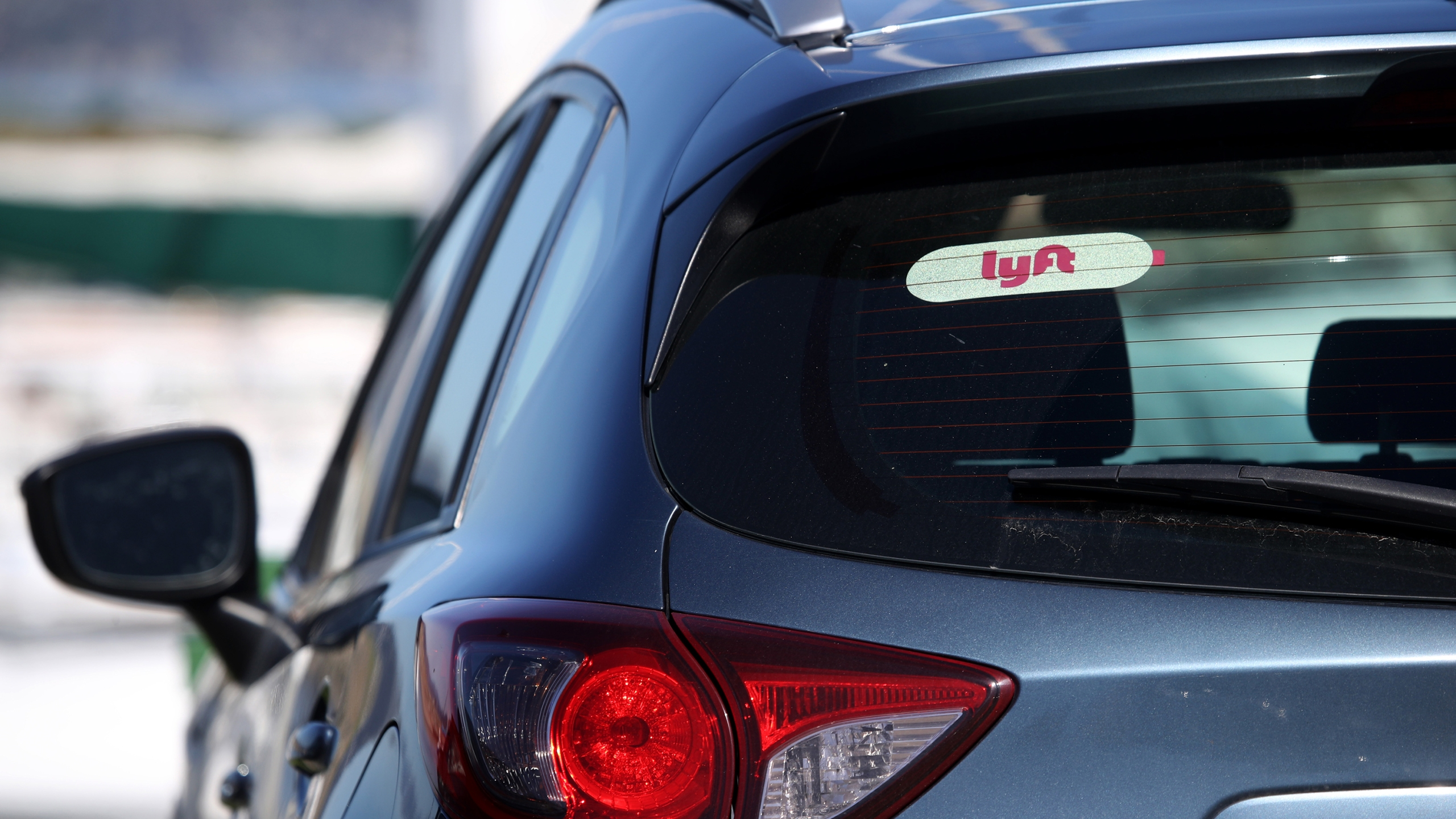 The Lyft logo is displayed on a car on March 11, 2019 in San Francisco, California. (Justin Sullivan/Getty Images)