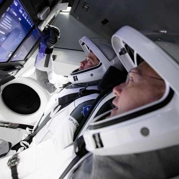 On Thursday, March 19 and Friday, March 20, SpaceX teams in Firing Room 4 at NASA's Kennedy Space Center in Florida and the company's Mission Control in Hawthorne, along with NASA flight controllers in Mission Control Houston, executed a full simulation of launch and docking of the Crew Dragon spacecraft, with NASA astronauts Bob Behnken and Doug Hurley (front) participating in SpaceX's flight simulator. (SpaceX)