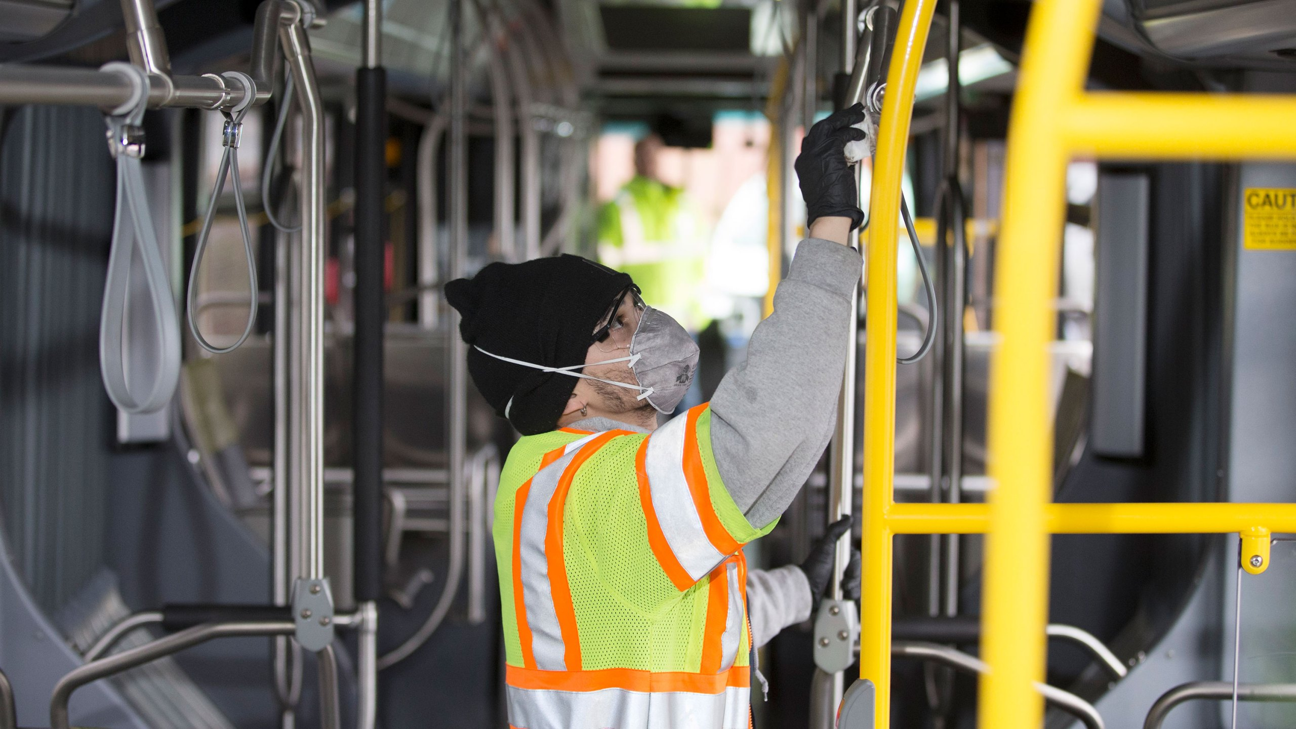 A utility service worker for King County Metro Transit, deep cleans a bus on March 3, 2020, in Seattle, Washington. (Karen Ducey/Getty Images)
