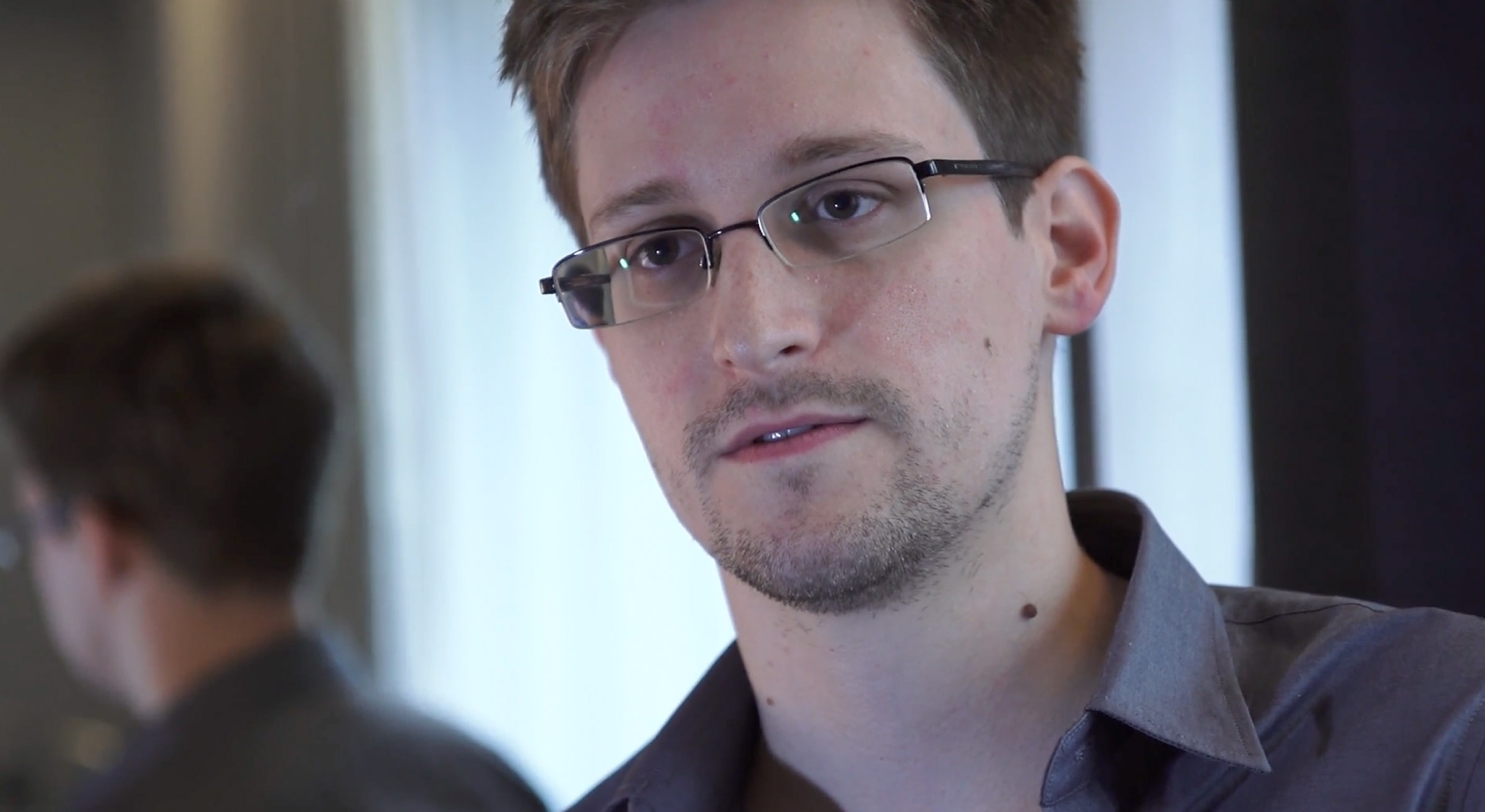 In this handout photo provided by The Guardian, Edward Snowden speaks during an interview in Hong Kong. Snowden, a 29-year-old former technical assistant for the CIA, revealed details of top-secret surveillance conducted by the United States' National Security Agency regarding telecom data. (Photo by The Guardian via Getty Images/CNN)