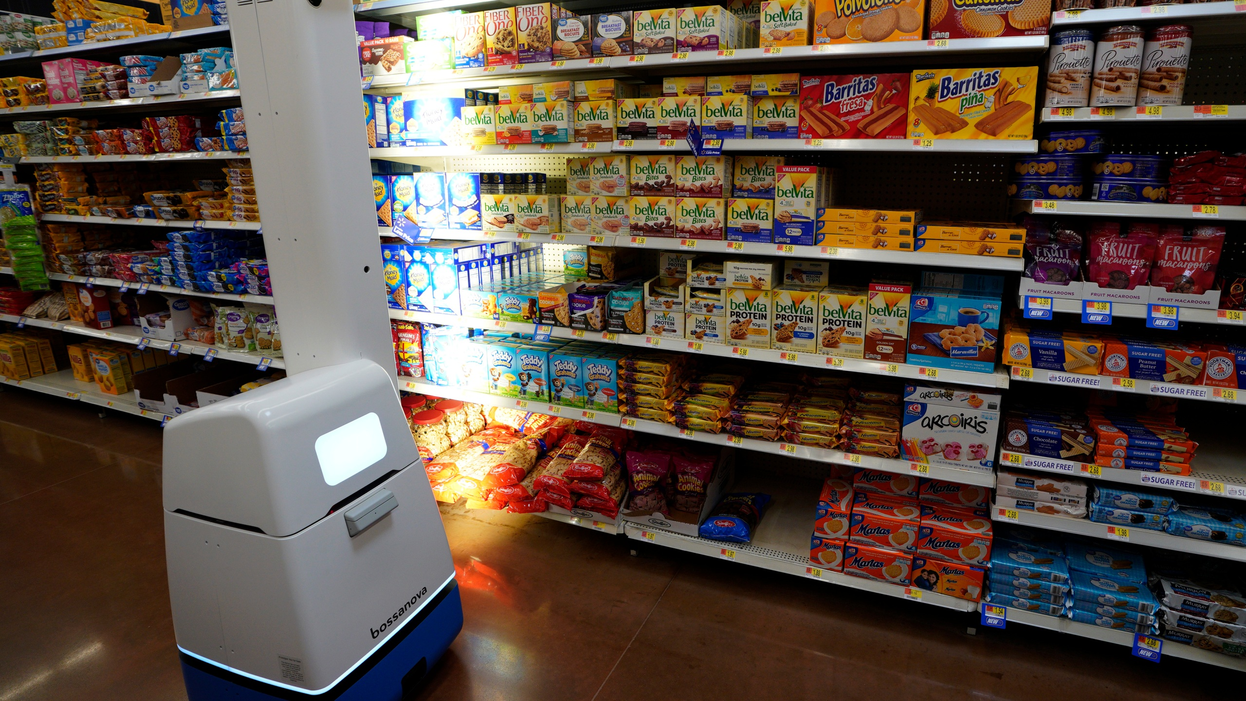 A Bossa Nova Robotics scanning device moves through an aisle at a Walmart Supercenter during the annual Shareholders Meeting event on May 31, 2018 in Rogers, Arkansas. (Rick T. /Getty Images)