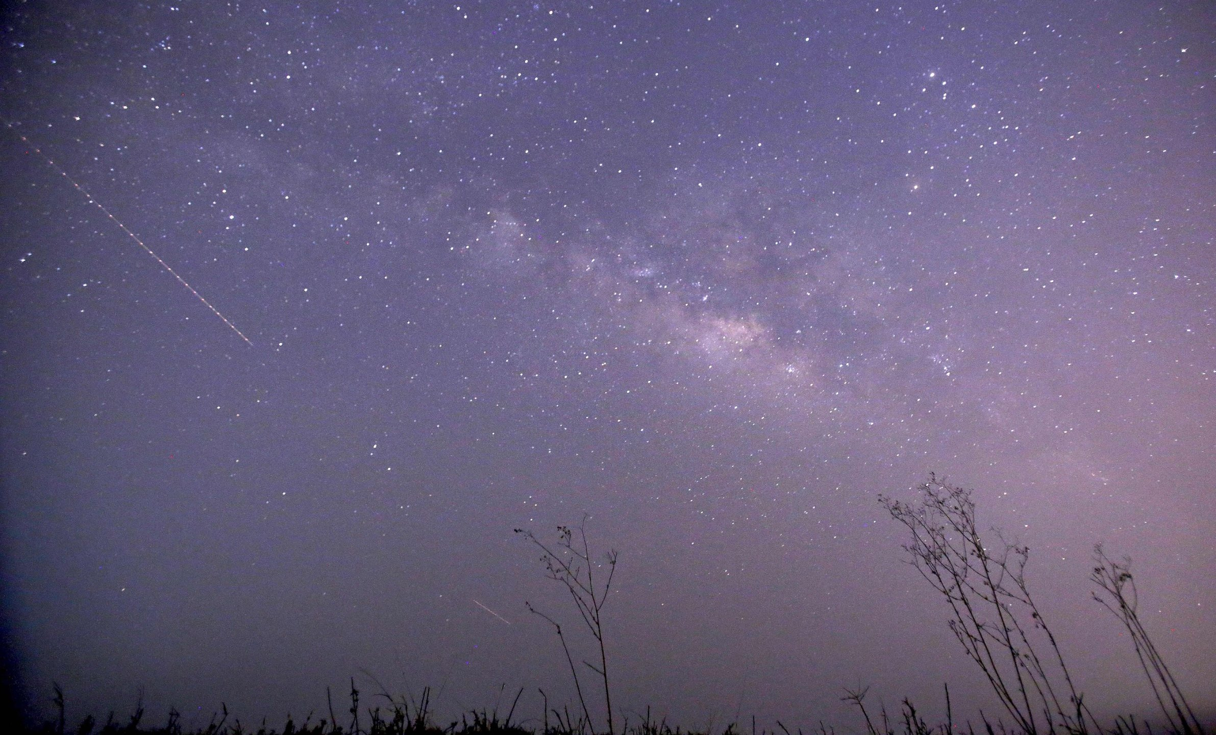 This long-exposure photograph shows Lyrids meteors shower passing near the Milky Way in the clear night sky of Thanlyin, nearly 14miles away from Yangon. (YE AUNG THU/AFP/Getty Images)