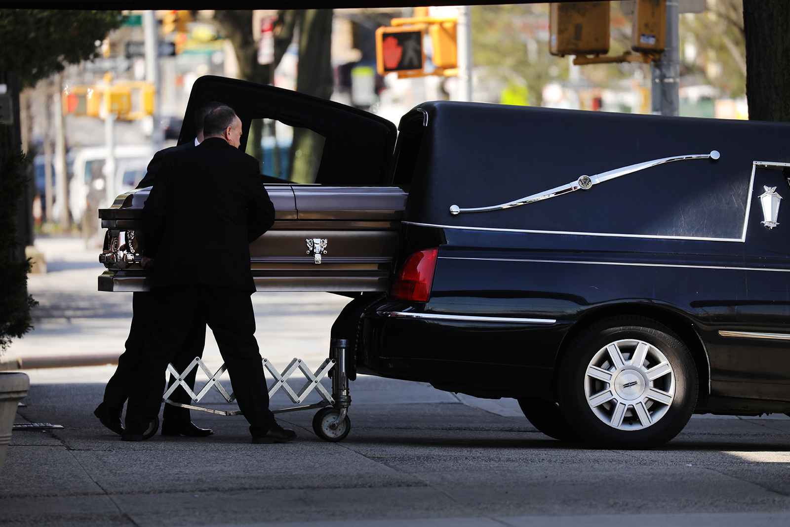 A casket is placed into a hearse outside of a funeral home in the heavily Orthodox Borough Park neighborhood of Brooklyn, which has seen a large number of deaths due to the coronavirus on April 16, 2020 in New York City. (Spencer Platt/Getty Images)