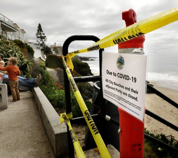 Laguna Beach closed all city beaches and adjacent parks on March 24. The city now plans to reopen the shoreline on weekday mornings. (Christina House / Los Angeles Times)