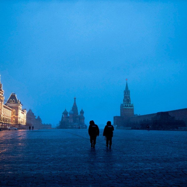 Two police officers patrol an almost empty Red Square, with St. Basil's Cathedral, center, and Spasskaya Tower and the Kremlin Wall, right, at the time when its usually very crowded in Moscow, Russia. (Alexander Zemlianichenko/AP)
