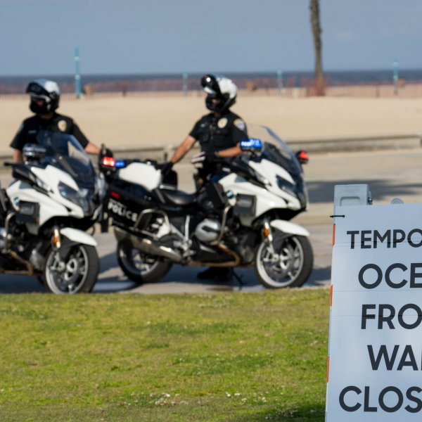 "The Santa Monica Police Department tweeted this photo on April 25, 2020 showing officers behind a sign that reads ""temporary ocean front walk closure."""