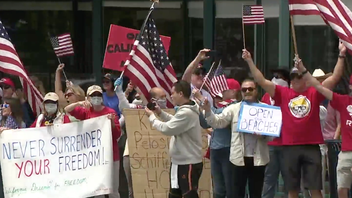 Protesters gather to rally against California's stay-at-home order during the coronavirus pandemic on April 18, 2020. (Credit: KSWB)