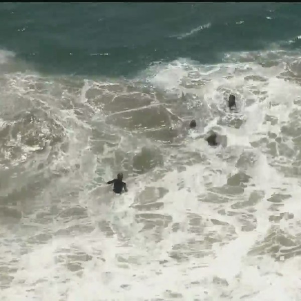 Surfers are seen at the Wedge in this file photo. (KTLA)