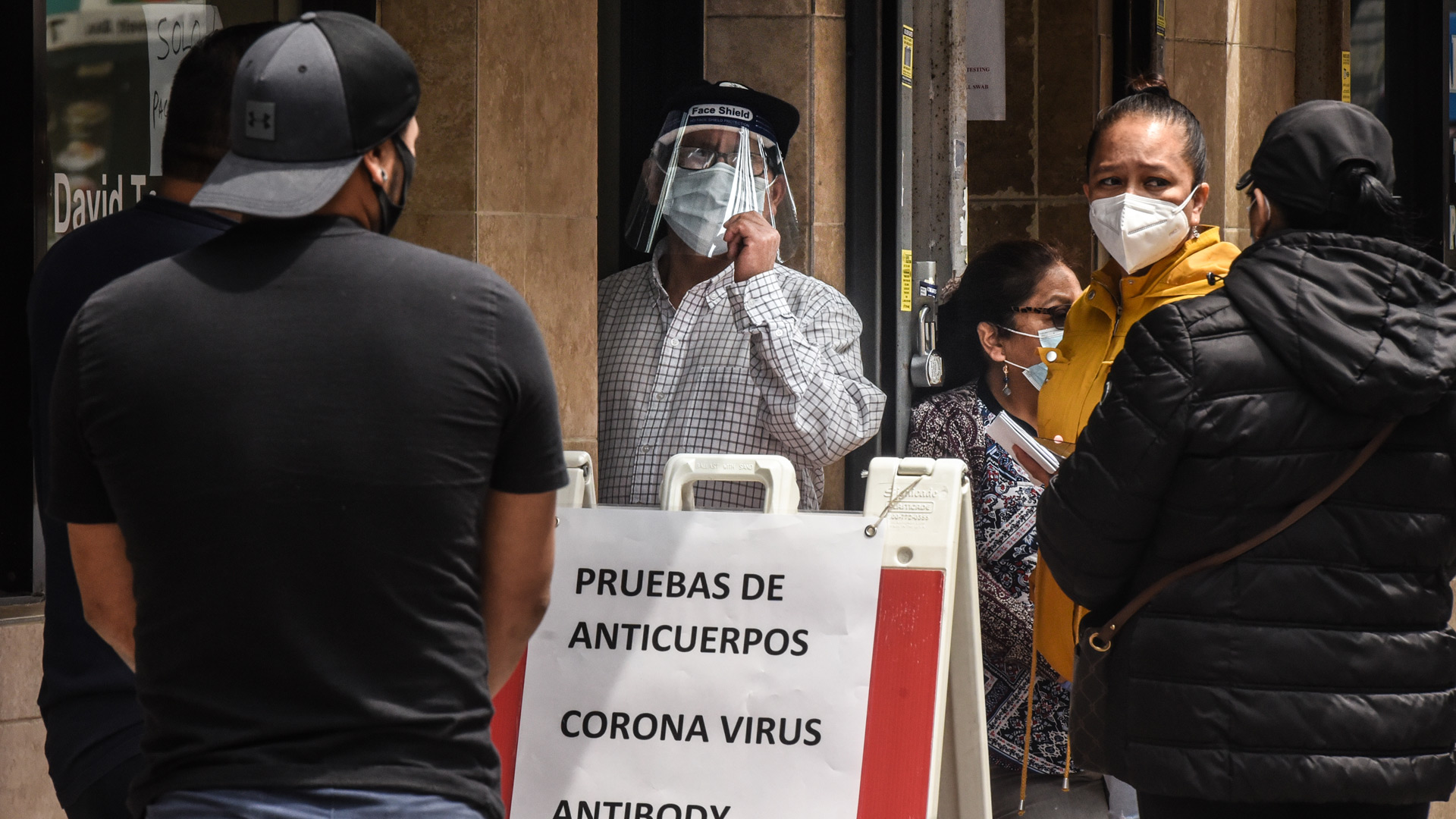 People wait to get an antibody test for COVID-19 on May 18, 2020 in the Queens borough in New York City. (Photo by Stephanie Keith/Getty Images)