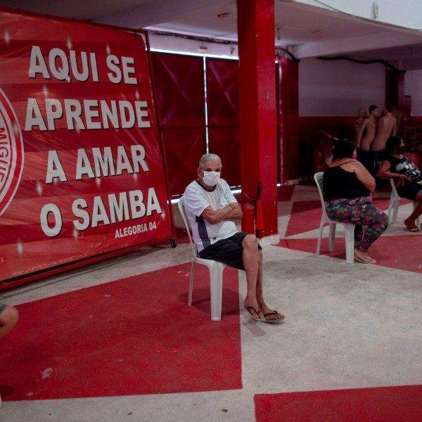 People wait to be attended by a physician during a day of free health checks for people showing symptoms of the novel coronavirus, COVID-19, at the Unidos de Padre Miguel samba school headquarters in Rio de Janeiro, Brazil, on May 24, 2020. (Mauro Puimentel/AFP/Getty Images)