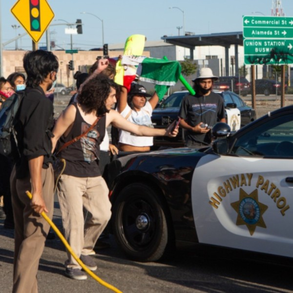 Protesters surround a CHP patrol car in downtown L.A. on May 27, 2020. (Gabriella Angotti-Jones)