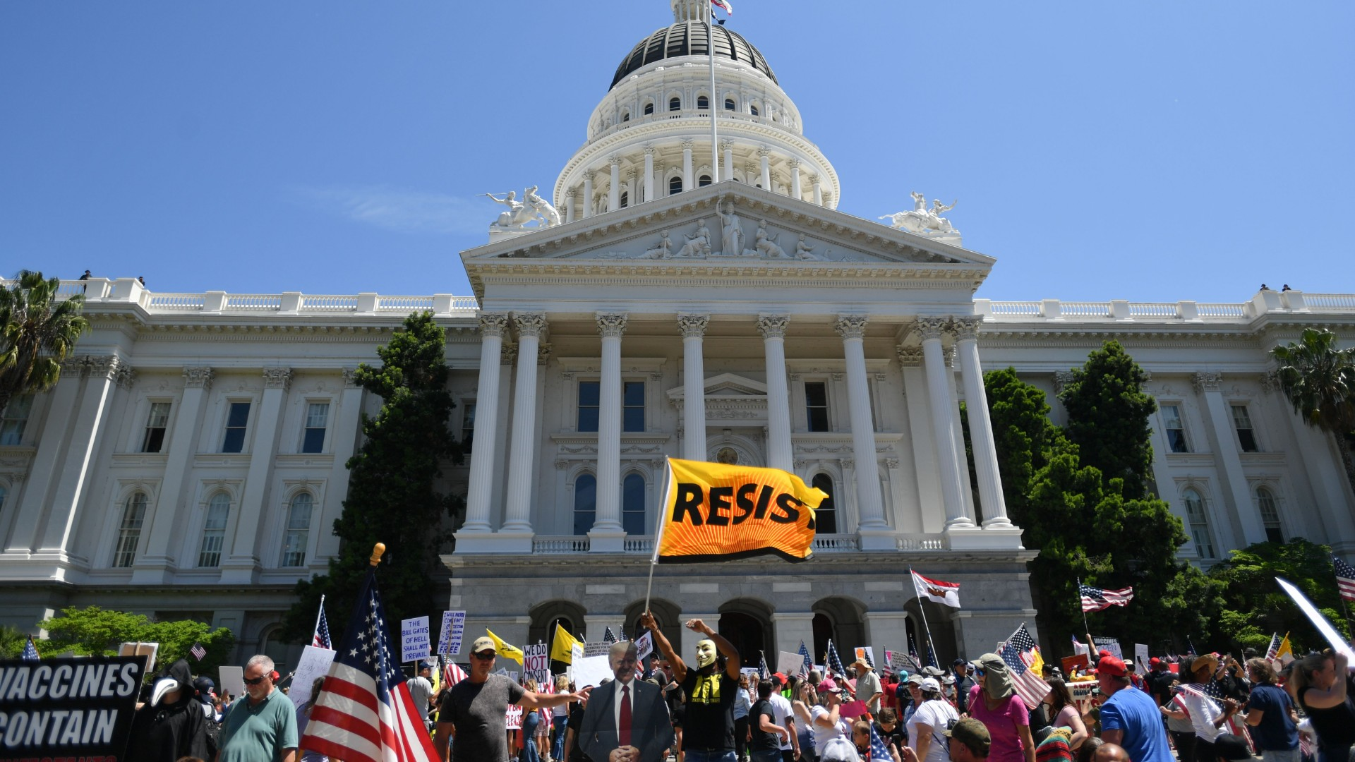 Hundreds gather to protest the shelter-in-place rules in effect amid the novel coronavirus pandemic at California's state capitol building in Sacramento, California on May 1, 2020. (Josh Edelson/AFP/Getty Images)